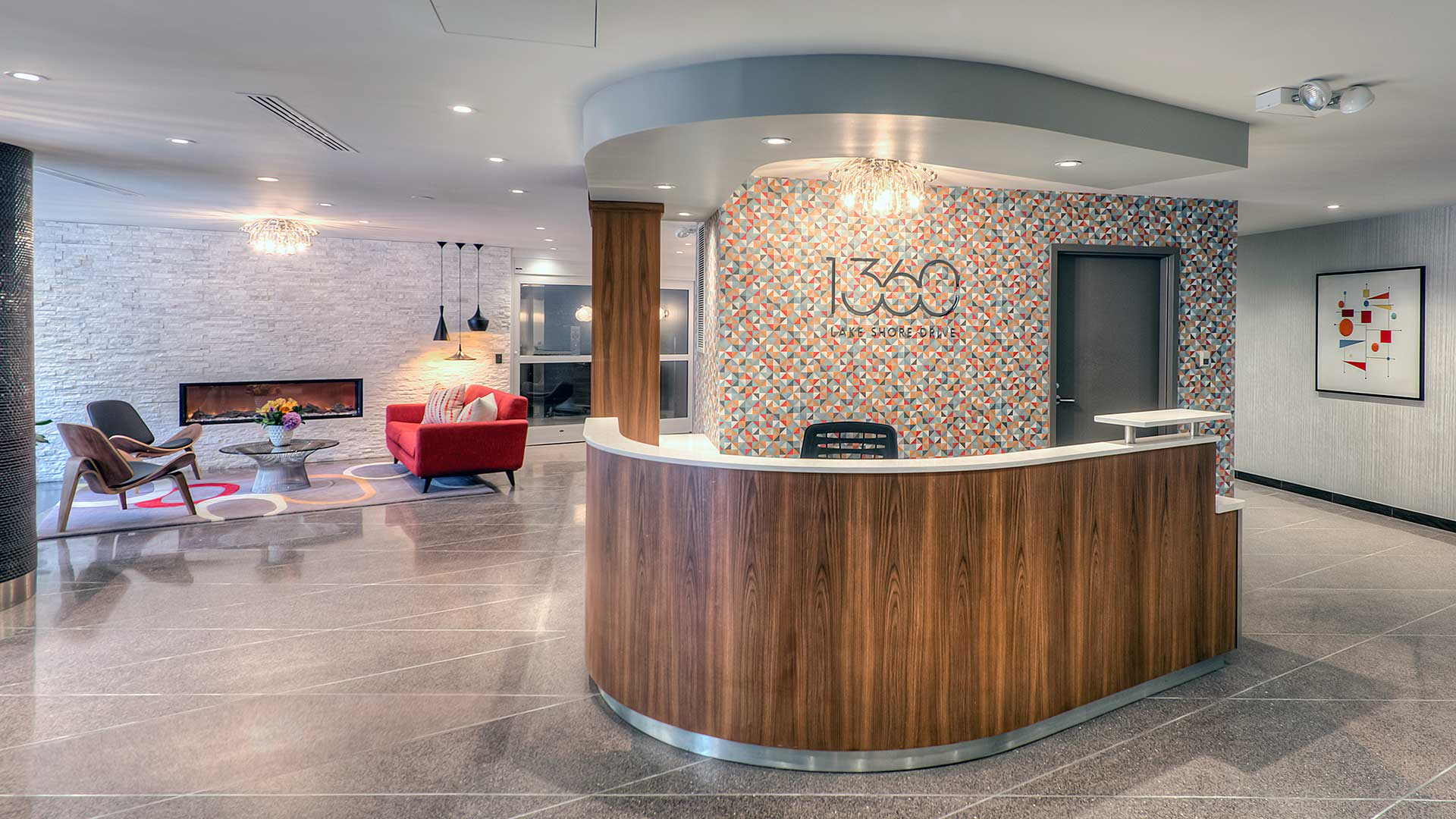 The front desk in the 1360 Lake Shore Drive lobby. A lounge area with fire place is seen further back to the left.